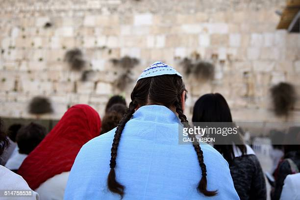 A member of the liberal Jewish religious group Women of the Wall wears a kippa the traditional Jewish skullcap for men and Tallit traditional Jewish...