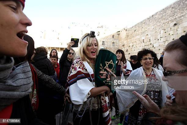 A member of the liberal Jewish religious group Women of the Wall wears phylacteries and Tallit a traditional Jewish prayer shawls for men as she...