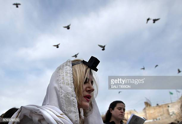 A member of the liberal religious group Women of the Wall wears phylacteries and a Tallit shawl traditional Jewish prayer apparel for men as she...