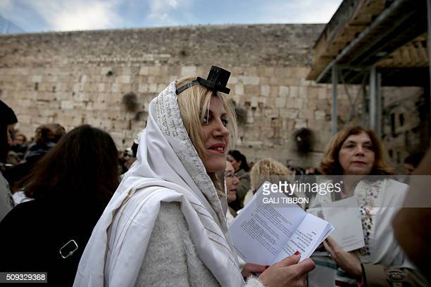 A member of the liberal religious group 'Women of the Wall' wears phylacteries and a 'Tallit' shawl traditional Jewish prayer apparel for men as she...