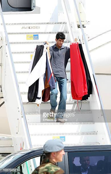 A member of the Libyan leader Muammar Gaddafi entourage carries clothes at the Ciampino airport on August 29 2010 in Rome Italy Gadaffi is on an...