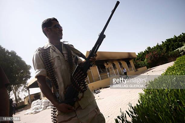 A member of the Libyan security forces secures the area during a visit by the head of Libya's national assembly Mohammed alMegaryef to the US...