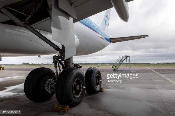 A member of the Line Maintenance Department wheels access steps near the landing gear of an Airbus SE A330200 aircraft while carrying out essential...