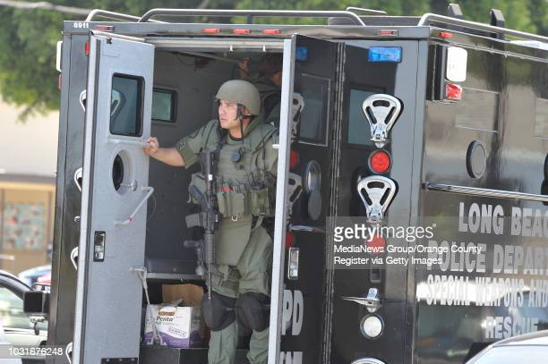 USA A member of the Long Beach SWAT team on May 13 in Long Beach CA as they search for a robbery suspect The suspect was captured Thursday afternoon...