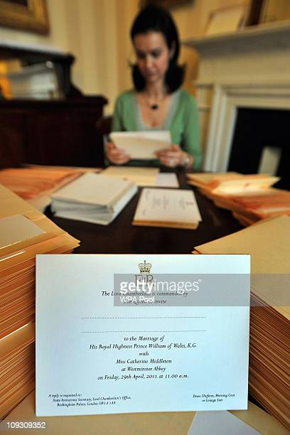 A member of the Lord Chamberlain's Office inserts Prince William and Kate Middleton's wedding invitations into envelopes at Buckingham Palace on...