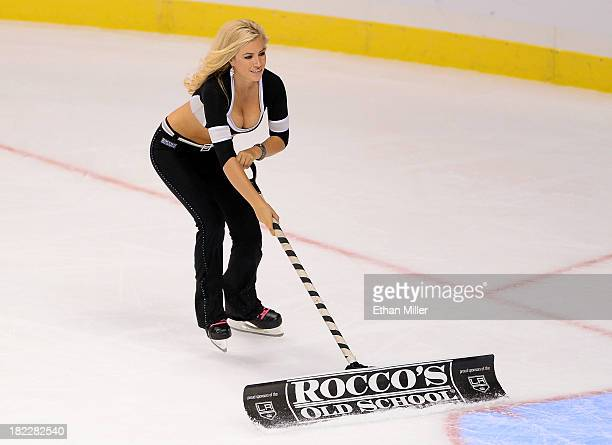 "Member of the Los Angeles Kings ice girls Allison ""Ally"" Mello cleans the ice during the team's preseason game against the Colorado Avalanche at the..."