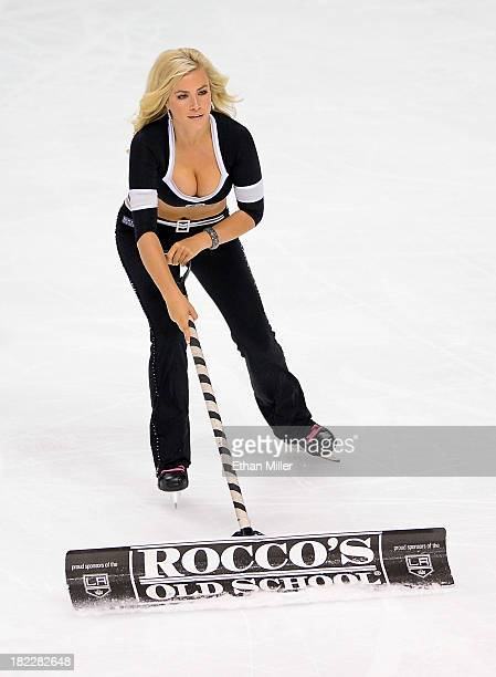 Member of the Los Angeles Kings ice girls Allison Ally Mello cleans the ice during the team's preseason game against the Colorado Avalanche at the...