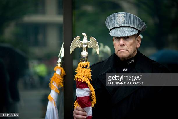 A member of the Los Angeles Police Department color guard waits to march May 14 2012 in Washington DC prior to the 18th Annual Emerald Society...
