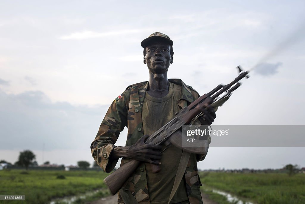 A member of the Lou Nuer tribe comes back home in the Yuai village, Uror county, Jonglei state in South Sudan, on July 23, 2013 after fighting against the rebel group of Yau Yau in Pibor county, South Sudan. Over 100,000 South Sudanese civilians are cut off from aid in the eastern state of Jonglei amid fierce fighting between rival ethnic groups, aid agencies and the United Nations warned on July 17.