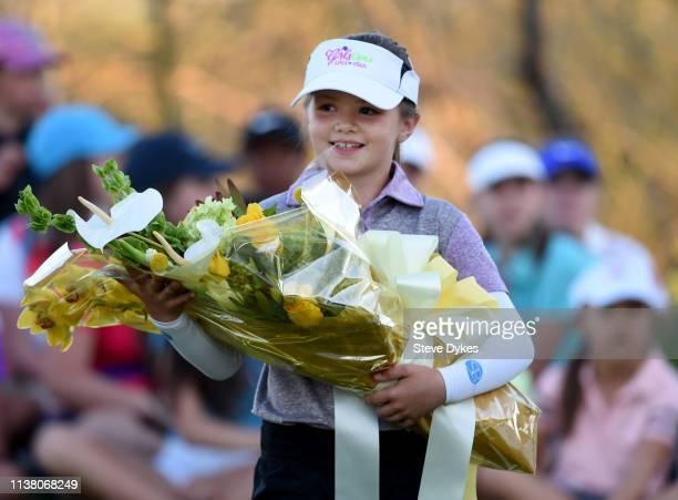 A member of the LPGAUSGA Girls Golf of Phoenix holds a some flowers to be presented to the winner of the Bank Of Hope Founders Cup at the Wildfire...