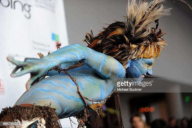 A member of the Lucent Dossier Experience attends the Earth Day celebration and screening of Avatar benefitting the Partnership for Los Angeles...