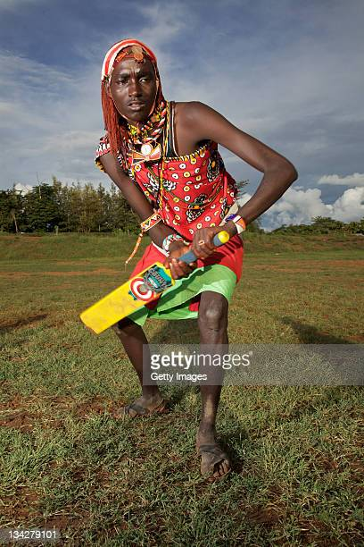 A member of the Maasai Cricket Warriors team in Kenya helps support the ICC's Think Wise awareness campaign on November 25 2011 in Laikipia Kenya...