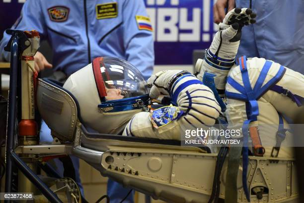 Member of the main crew of the 50/51 expedition to the International Space Station US astronaut Peggy Whitson looks through the visor of her helmet...