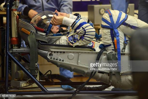 Member of the main crew of the 50/51 expedition to the International Space Station US astronaut Peggy Whitson shuts her helmet's visor as her space...