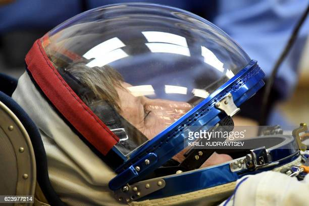 Member of the main crew of the 50/51 expedition to the International Space Station US astronaut Peggy Whitson wears his space suit as it's tested at...