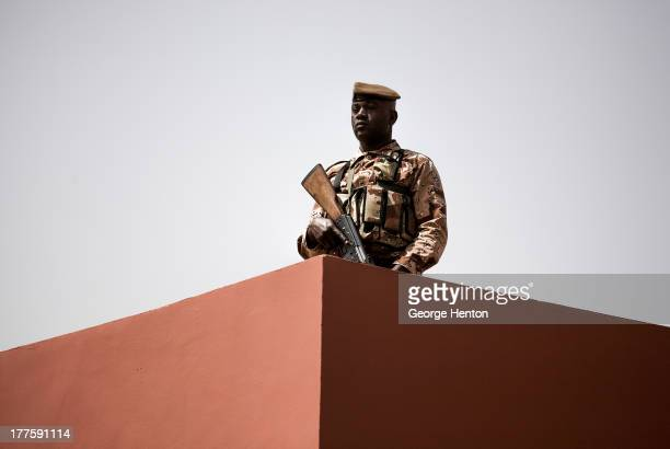 Member of the Malian armed forces stands guard at Bamako-Senou Airport airport as officials await the arrival of French President Francois Hollande...
