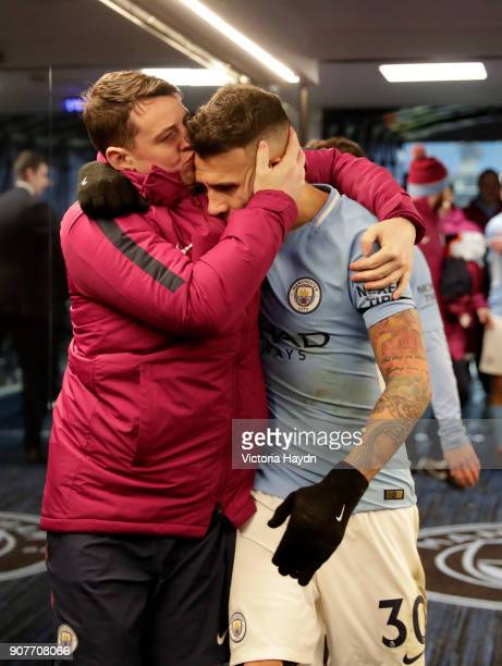 A member of the Manchester City staff kisses Nicolas Otamendi of Manchester City in the tunnel after the Premier League match between Manchester City...