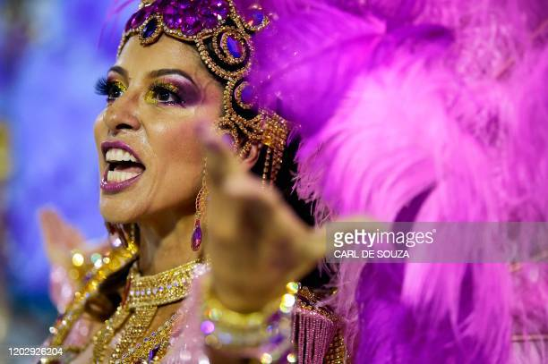 A member of the Mangueira samba school performs during the first night of Rio's carnival parade at the Sambadrome in Rio de Janeiro Brazil on...