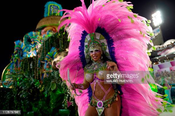 Member of the Mangueira samba school performs during the second night of Rio's Carnival parade at the Sambadrome in Rio de Janeiro, Brazil on March...
