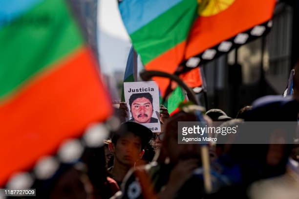 Member of the Mapuche community holds a portrait of Camilo Catrillanca at Plaza de Armas during a protest against president Sebastian Piñera to...