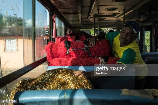 A member of the Maracatu group removes the costumes transported by bus to the presentation in the city of Nazaré da Mata in Northeast Brazil on...