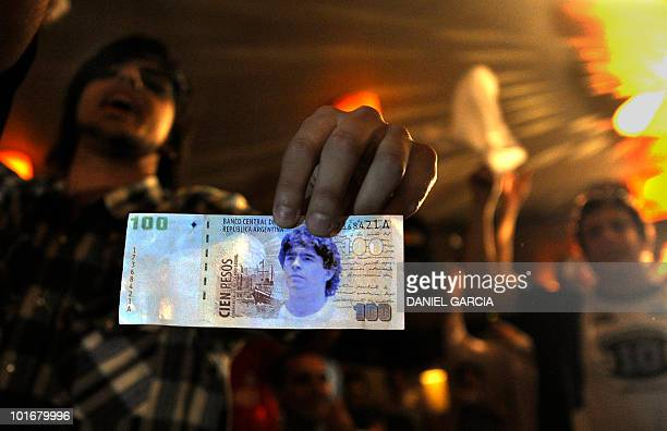 A member of the Maradonian Church The hand of God a religion dedicated to the Argentina's greatest ever soccer player Diego Maradona shows a fake one...