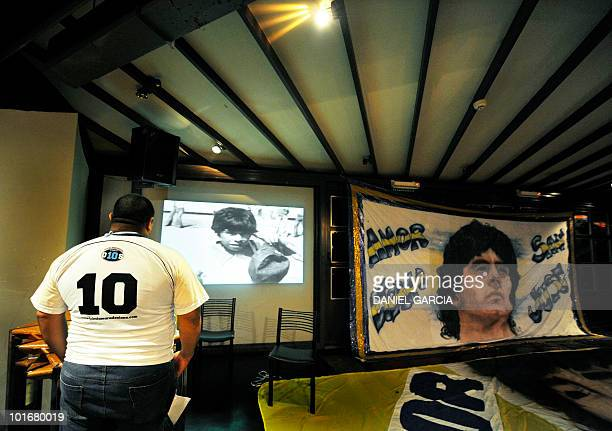 A member of the Maradonian Church The hand of God a religion dedicated to the Argentina's greatest ever soccer player Diego Maradona watches a video...