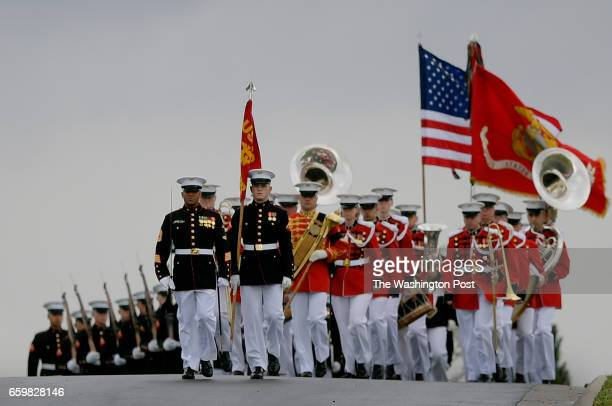Member of the Marine Corps Band with honor guard preceeds a caisson transfering the remains of Marine Pvt Harry K Tye of Orinoco Kentucky to his gave...