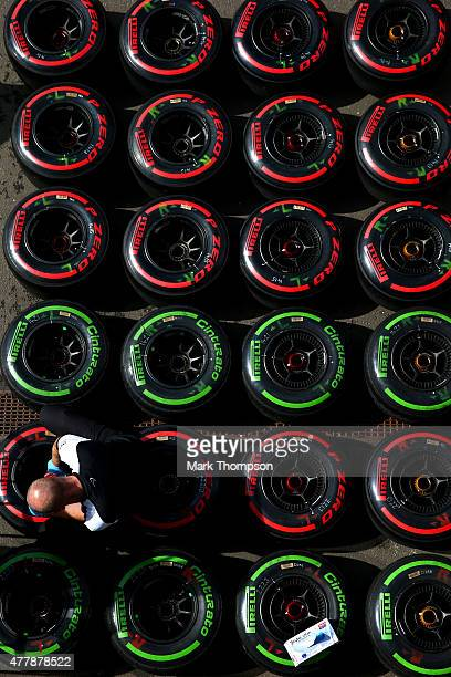 Member of the McLaren Honda team checks tyres outside the garage after qualifying for the Formula One Grand Prix of Austria at Red Bull Ring on June...