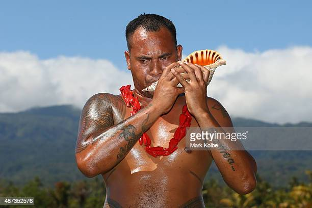 A member of the medal ceremony team blows a seashell horn during the athletics competition at the Apia Park Sports Complex on day three of the Samoa...