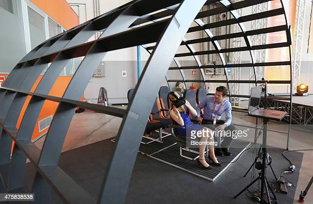 A member of the media center tries an Oculus VR Inc virtual reality headset used to train Easyjet cabin crew during a demonstration at the 'Easyjet...