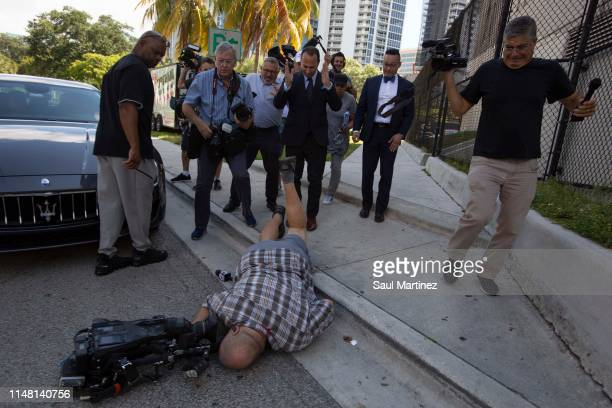 A member of the media falls while Defense attorneys David Sobel and Joseph DiRuzzo lawyers of former Sheriff's Deputy Scot Peterson leave the Broward...