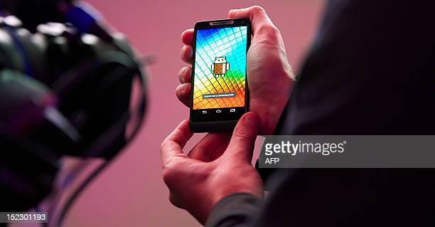 A member of the media holds a new Motorola RAZRi smartphone with an Intel processor during the press launch of the device in London on September 18...