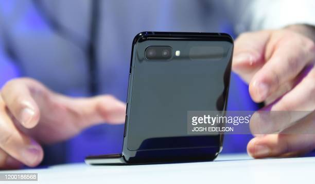 A member of the media holds a Samsung Galaxy Z Flip phone during the Samsung Galaxy Unpacked 2020 event in San Francisco California on February 11...