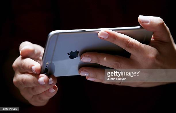 Member of the media inspects the new iPhone 6 during an Apple special event at the Flint Center for the Performing Arts on September 9, 2014 in...