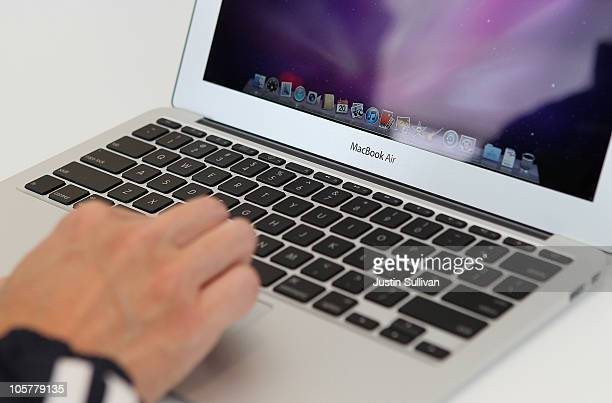 A member of the media looks at a display of the new Mac Book Air during an Apple special event at the company's headquarters on October 20 2010 in...