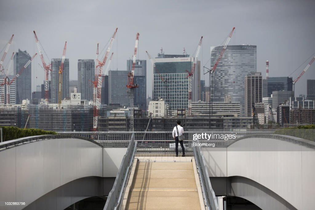 A member of the media looks at buildings from the rooftop garden at Toyosu Market in Tokyo, Japan, on Thursday, Sept. 13, 2018. The Toyosu Market, where the iconic Tsukiji fish market will relocate to, is scheduled to being operations on Oct. 11. Photographer: Tomohiro Ohsumi/Bloomberg via Getty Images
