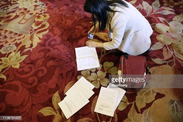 A member of the media photographs the annual work report ahead of the opening of the Second Session of the 13th National People's Congress at the...