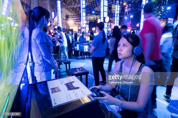 Member of the media plays a video game in the Sony Interactive Entertainment Inc. Booth on the business day of the Tokyo Game Show 2019 at Makuhari...