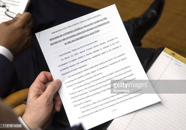 A member of the media reads prepared remarks before a news conference with William Barr US attorney general not pictured at the US Department of...