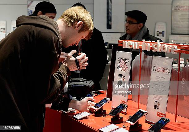 A member of the media shoots video of a new Blackberry Z10 device displayed on the first day of sales at a Rogers Communications Inc store in Toronto...