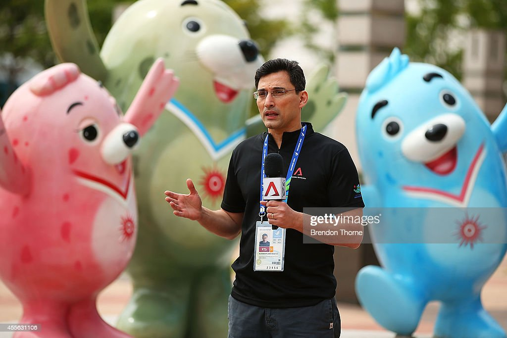 A member of the media speaks to camera outside the International Broadcast Centre prior to the 17th Asian Games on September 18, 2014 in Incheon, South Korea.