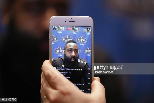 A member of the media streams James Harden of the Houston Rockets on an iPhone as he speaks with the media during media availability for the 2017 NBA...