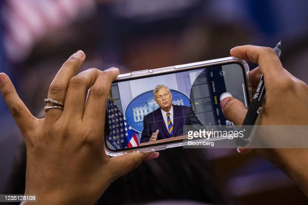 Member of the media takes a photograph of Tom Vilsack, U.S. Secretary of agriculture, while speaking during a news conference in the James S. Brady...