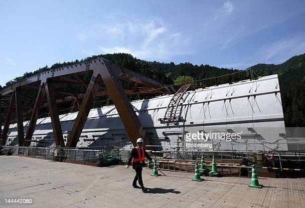 A member of the media walks past the Akiyama tunnel which is under construction for Central Japan Railway Co's magneticlevitation train line in...