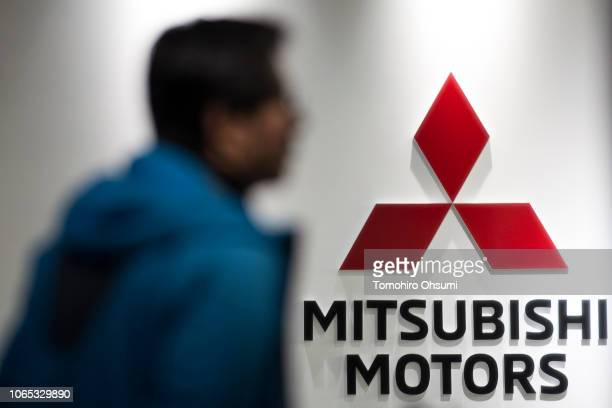 Member of the media walks past the Mitsubishi Motors Corp. Logo at the company's headquarters on November 26, 2018 in Tokyo, Japan. Mitsubishi...