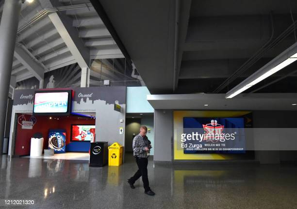 A member of the media walks through an empty Sprint Center after it was announced that the Big 12 Men's Tournament was canceled due to concerns with...