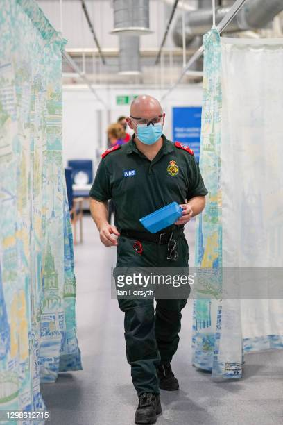 Member of the medical staff assists with Covid-19 vaccinations at the NHS Nightingale North East hospital on January 26, 2021 in Sunderland, England....