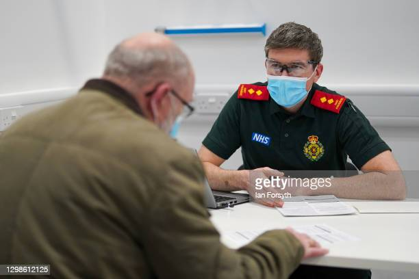 Member of the medical staff at NHS Nightingale North East take a patients details as they wait to receive the AstraZeneca/Oxford University Covid-19...