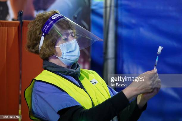 Member of the medical staff draws up the Pfizer-BioNTech COVID-19 vaccine at a new 'Pop Up' vaccination centre in the Big Top of Circus Extreme in...